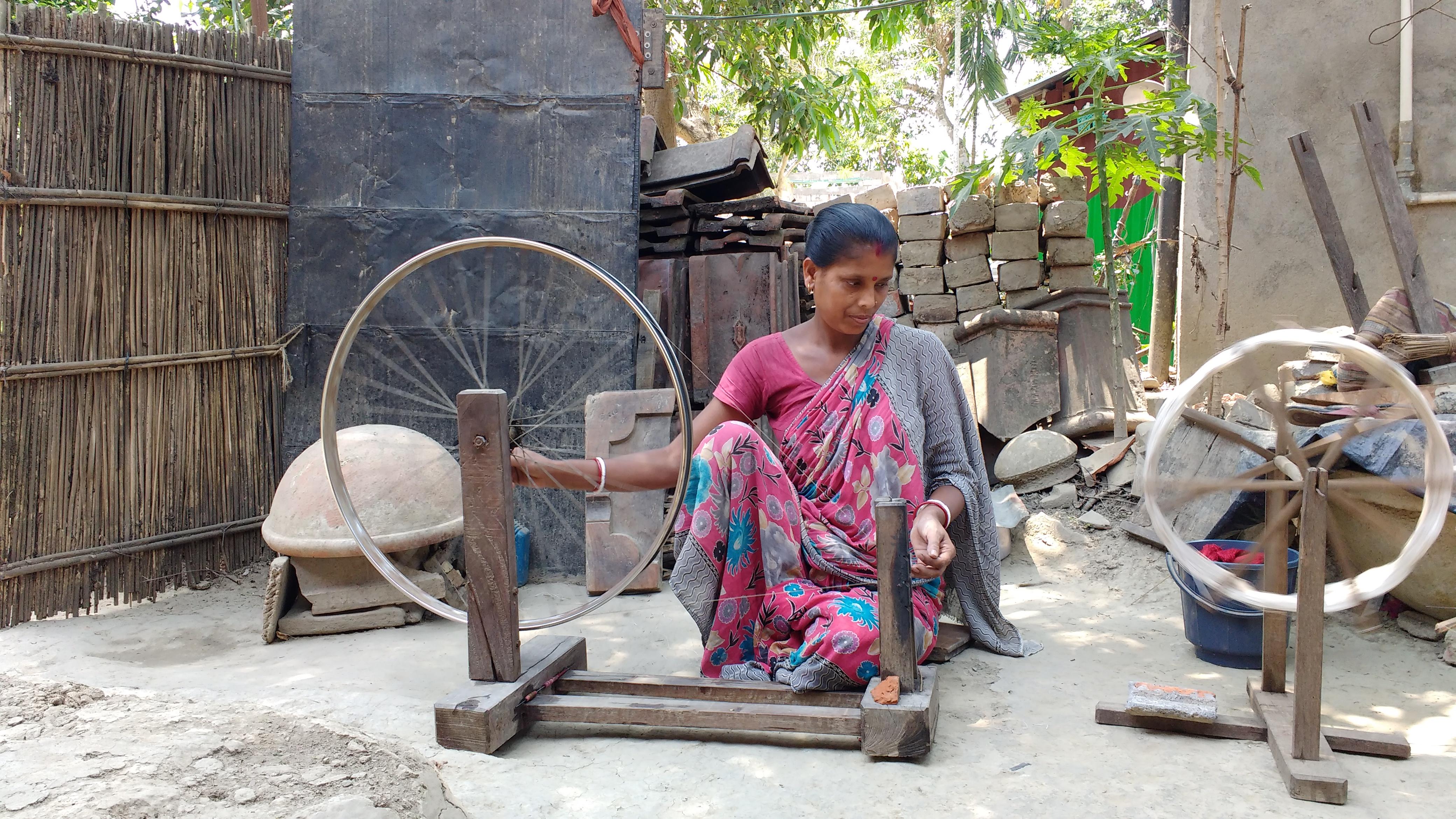 Shanti Basak spinning the khaki and cotton yarn
